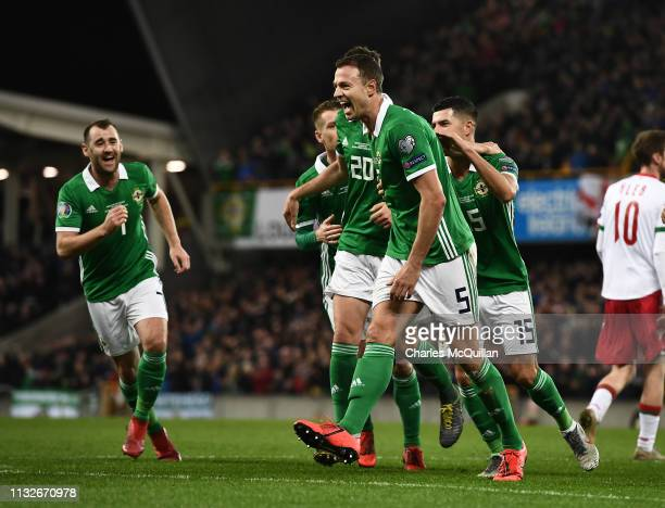 Jonny Evans of Northern Ireland celebrates after scoring during the 2020 UEFA European Championships group C qualifying match between Northern...
