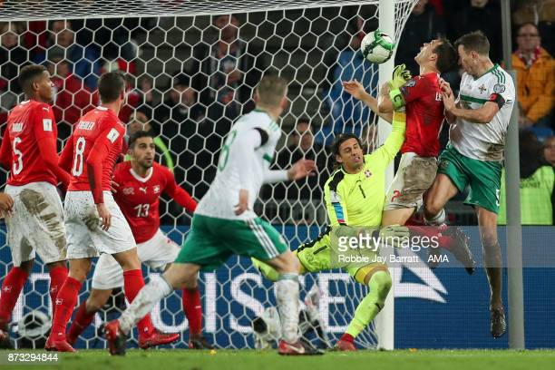 Jonny Evans of Northern Ireland heads towards goal during the FIFA 2018 World Cup Qualifier PlayOff Second Leg between Switzerland and Northern...