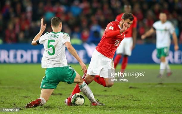 Jonny Evans of Northern Ireland tackles Admir Mehemedi of Switzerland during the FIFA 2018 World Cup Qualifier PlayOff Second Leg between Switzerland...
