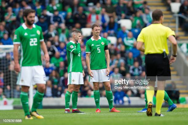 Jonny Evans of Northern Ireland talks to team mate Oliver Norwood during the UEFA Nations League B group three match between Northern Ireland and...