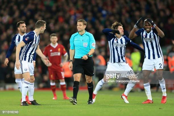 Jonny Evans of West Brom Grzegorz Krychowiak of West Brom and AllanRomeo Nyom of West Brom react after referee Craig Pawson awarded a penalty...