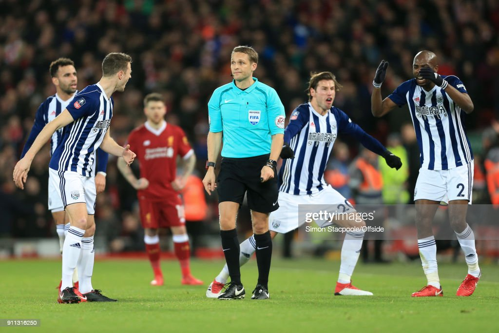 Jonny Evans of West Brom (2L), Grzegorz Krychowiak of West Brom (2R) and Allan-Romeo Nyom of West Brom (R) react after referee Craig Pawson awarded a penalty following a decision to refer to the Video Assistant Referee (VAR) system during The Emirates FA Cup Fourth Round match between Liverpool and West Bromwich Albion at Anfield on January 27, 2018 in Liverpool, England.