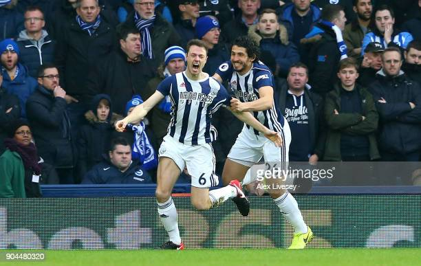 Jonny Evans of West Bromwich Albion celebrates after scoring his sides first goal with Ahmed ElSayed Hegazi of West Bromwich Albion during the...