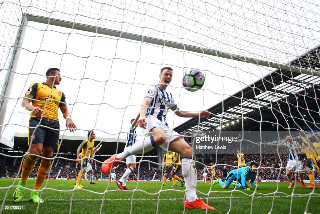 Jonny Evans of West Bromwich Albion (C) celebrates as Craig Dawson of West Bromwich Albion (not pictured) scores his sides first goal during the Premier League match between West Bromwich Albion and Arsenal at The Hawthorns on March 18, 2017 in West Bromwich, England.