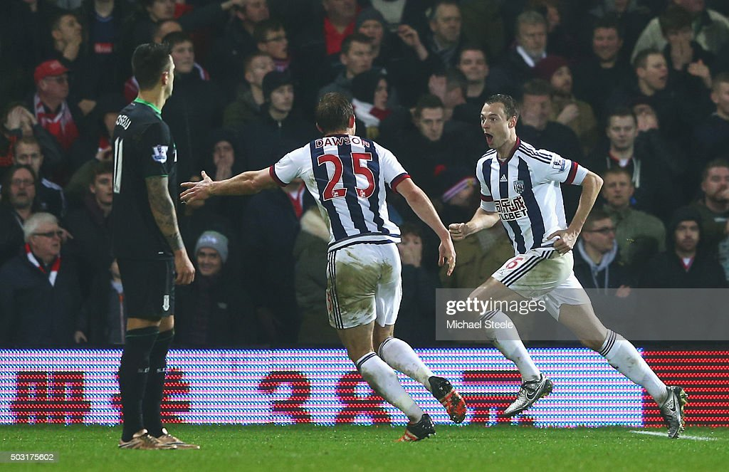 Jonny Evans (R) of West Bromwich Albion celebrates scoring his team's second goal with his team mate Craig Dawson (C) during the Barclays Premier League match between West Bromwich Albion and Stoke City at The Hawthorns on January 2, 2016 in West Bromwich, England.