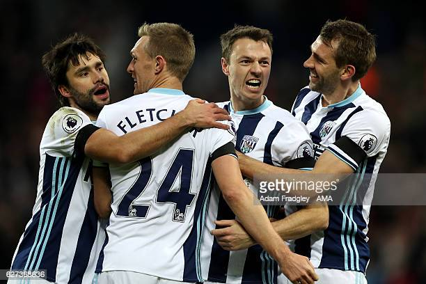 Jonny Evans of West Bromwich Albion celebrates scoring the first goal during the Premier League match between West Bromwich Albion and Watford at The...