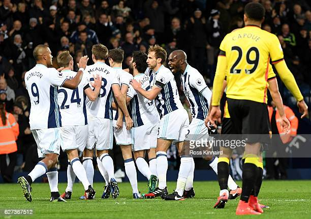 Jonny Evans of West Bromwich Albion celebrates scoring the opening goal with his team mates during the Premier League match between West Bromwich...