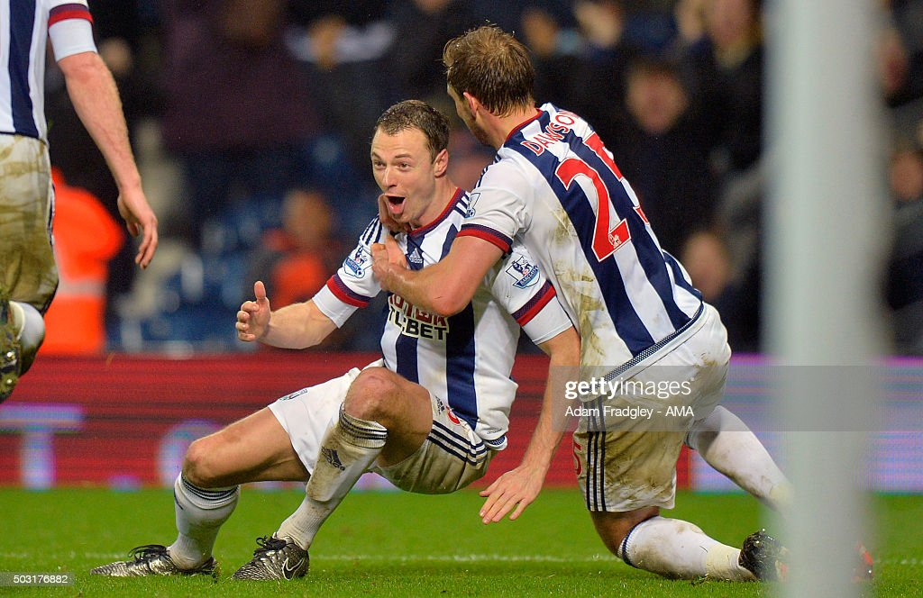 Jonny Evans of West Bromwich Albion celebrates with Craig Dawson of West Bromwich Albion after scoring a goal to make it 2-1 during the Barclays Premier League match between West Bromwich Albion and Stoke City at The Hawthorns on January 02, 2016 in West Bromwich, England.