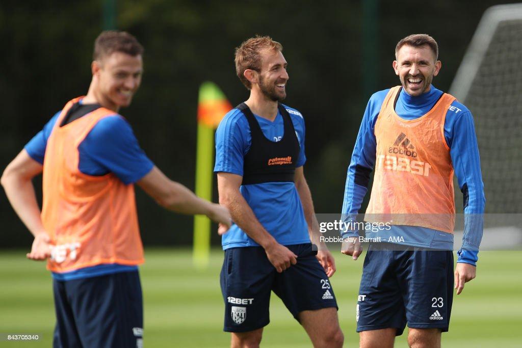 Jonny Evans of West Bromwich Albion, Craig Dawson of West Bromwich Albion and Gareth McAuley of West Bromwich Albion share a joke on September 7, 2017 in West Bromwich, England.