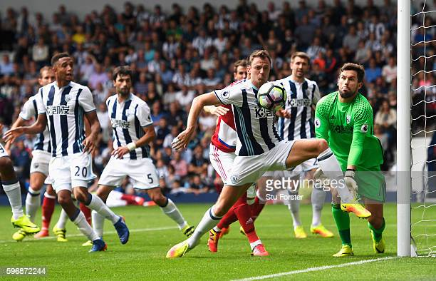Jonny Evans of West Bromwich Albion defends his goal with goalkeeper Ben Foster during the Premier League match between West Bromwich Albion and...