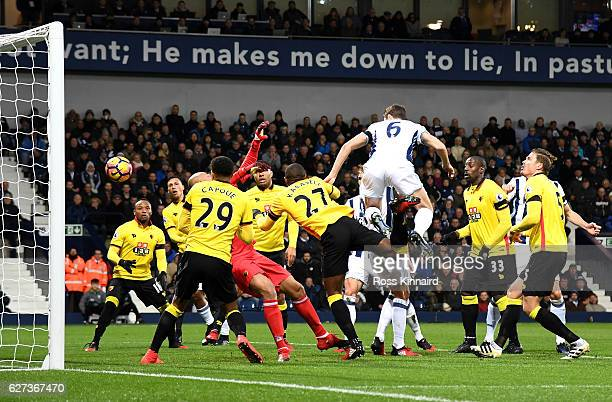 Jonny Evans of West Bromwich Albion heads to score the opening goal during the Premier League match between West Bromwich Albion and Watford at The...