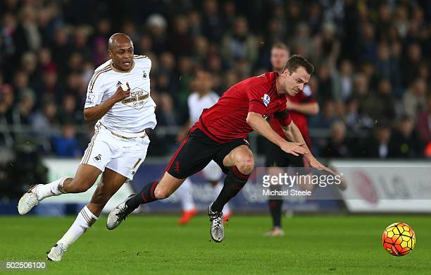 Jonny Evans of West Bromwich Albion is brought down by Andre Ayew of Swansea City during the Barclays Premier League match between Swansea City and...