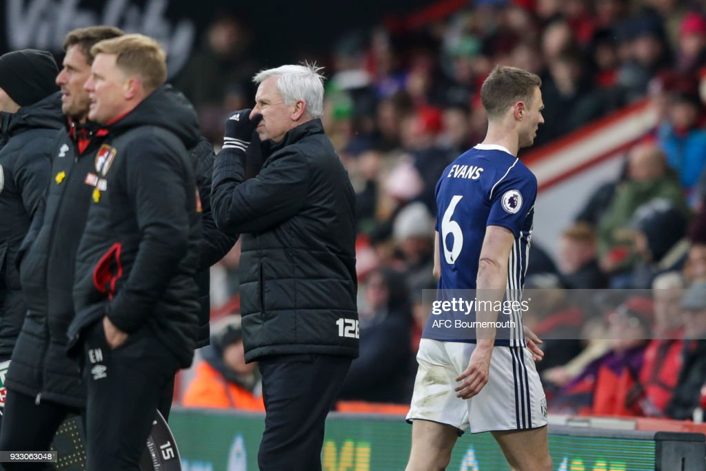 Jonny Evans of West Bromwich Albion passes West Brom manager Alan