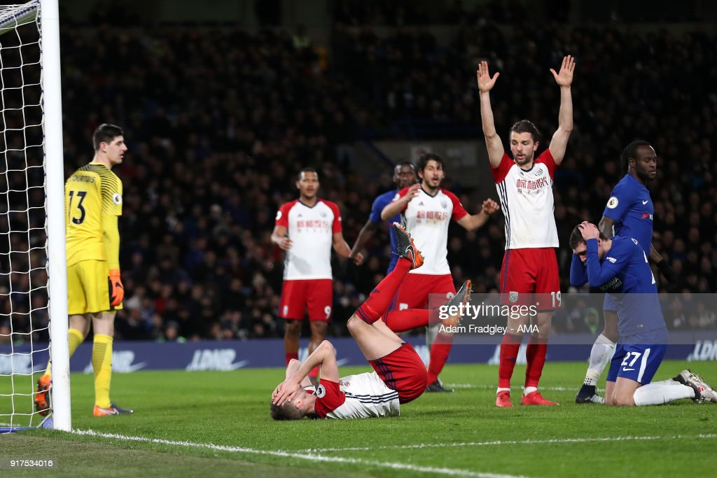 Jonny Evans of West Bromwich Albion reacts after a clash of heads with Andreas Christensen of Chelsea during the Premier League match between Chelsea and West Bromwich Albion at Stamford Bridge on February 12, 2018 in London, England.