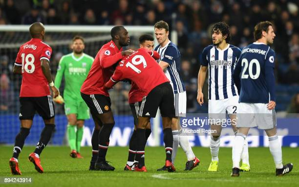 Jonny Evans of West Bromwich Albion Romelu Lukaku of Manchester United and teammate Jesse Lingard hold back Marcus Rashford during a confrontation...