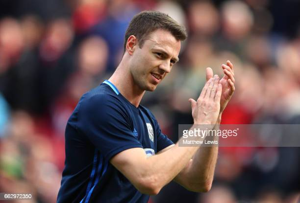 Jonny Evans of West Bromwich Albion shows appreciation to the fans prior to the Premier League match between Manchester United and West Bromwich...