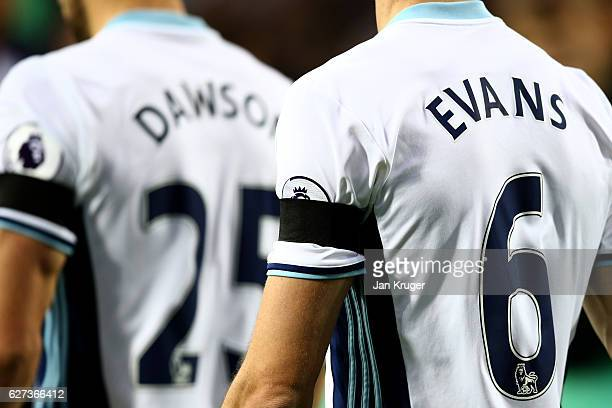 Jonny Evans of West Bromwich Albion wears a black armband to remember the victims of the plane crash involving the Brazilian club Chapecoense prior...