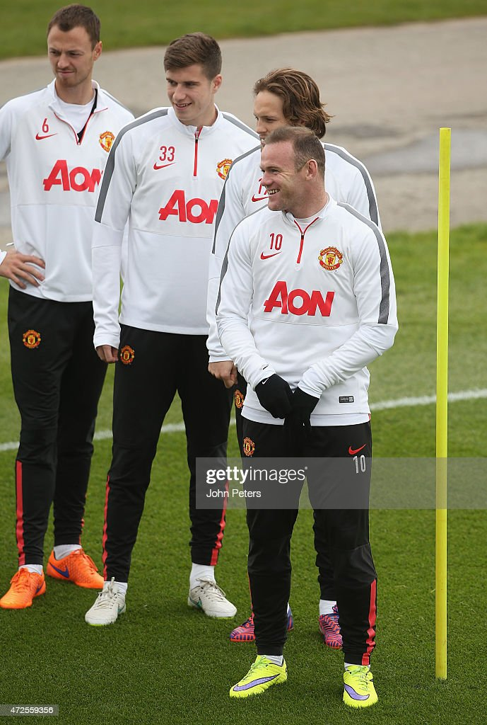 Jonny Evans, Patrick McNair, Daley Blind and Wayne Rooney of Manchester United in action during a first team training session at Aon Training Complex on May 8, 2015 in Manchester, England.