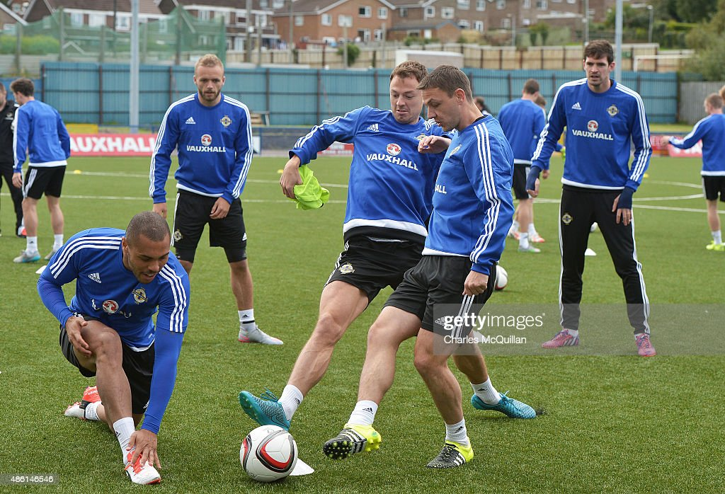 Jonny Evans (3rd L) tackles Chris Baird (4th L) of Northern Ireland as the international football squad train on Bangor F.C's plastic pitch on September 1, 2015 in Bangor, Northern Ireland. Northern Ireland travel to face the Faroe Islands in a Euro 2016 Group F qualifiying game in Torshavn on Friday evening.
