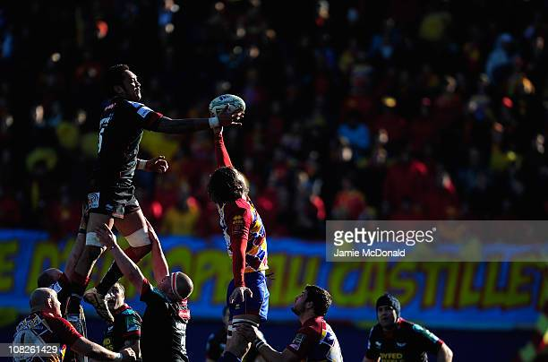 Jonny Fa Amatuainu of Scarlets jumps in the line out with Damien Chouly of Perpignan during the Heineken Cup Pool 5 match between Perpignan and...