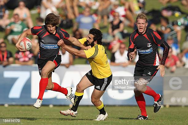 Jonny Fawls of Dubai Exiles 1 escapes the challenge of Adnan Saeed Niazi of Dubai Wasps during the Dubai Wasps versus Dubai Exiles 1 match in the...