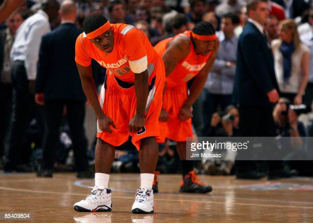 Jonny Flynn and Paul Harris of the Syracuse Orange look on during the 4th overtime against the Connecticut Huskies during the quarterfinals of the...