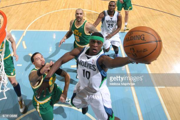 Jonny Flynn of the Minnesota Timberwolves goes up for the layup against Deron Williams of the Utah Jazz at EnergySolutions Arena on March 17 2010 in...