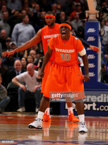 Jonny Flynn of the Syracuse Orange celebrates between plays in overtime against the Connecticut Huskies during the quarterfinals of the Big East...