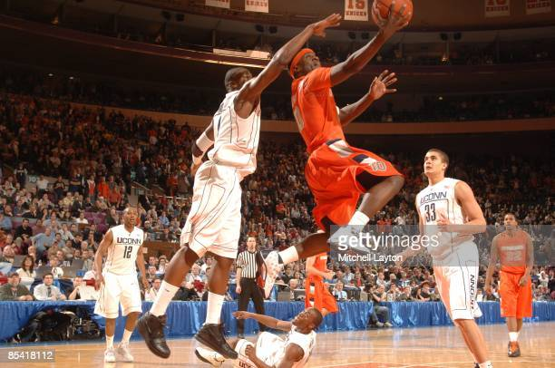 Jonny Flynn of the Syracuse Orange takes a shot over Jeff Adrain of the Connecticut Huskies during a quarterfinal Big East Conferance Touranment...