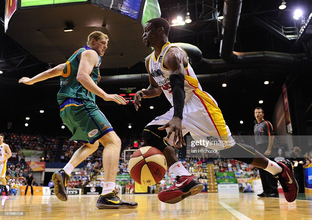 Jonny Flynn of the Tigers drives to the basket past Luke Nevill of the Crocodiles during the round ten NBL match between the Townsville Crocodiles and the Melbourne Tigers at Townsville Entertainment Centre on December 8, 2012 in Townsville, Australia.