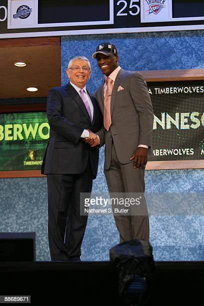 Jonny Flynn shakes hands with NBA Commissioner David Stern after being selected sixth by the Minnesota Timberwolves during the 2009 NBA Draft on June...