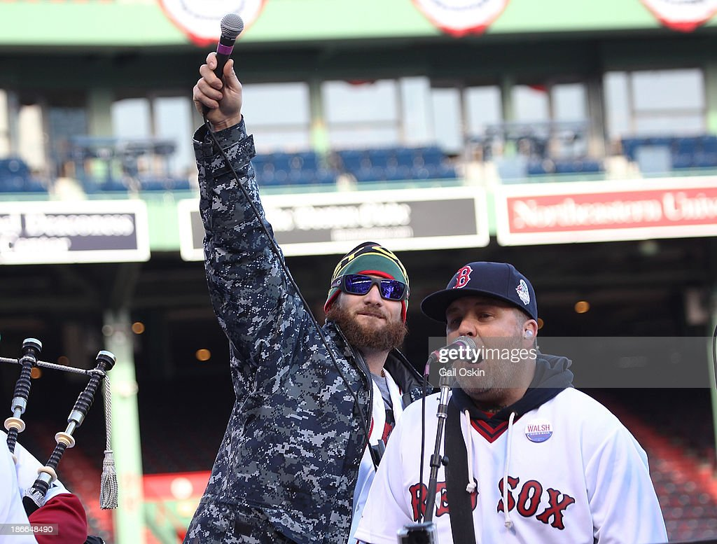 Jonny Gomes (L) and Ken Casey of the Drop Kick Murphys perform for the crowd before the Red Sox players board the duck boats for the World Series victory parade for the Boston Red Sox on November 2, 2013 in Boston, Massachusetts.