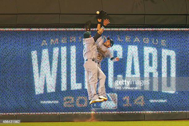 Jonny Gomes and Sam Fuld of the Oakland Athletics collide on a triple hit by Eric Hosmer of the Kansas City Royals in the 12th inning during the...