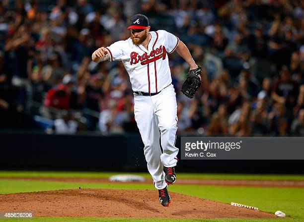 Jonny Gomes of the Atlanta Braves reacts after striking out Bryan Mitchell of the New York Yankees to end the ninth inning at Turner Field on August...