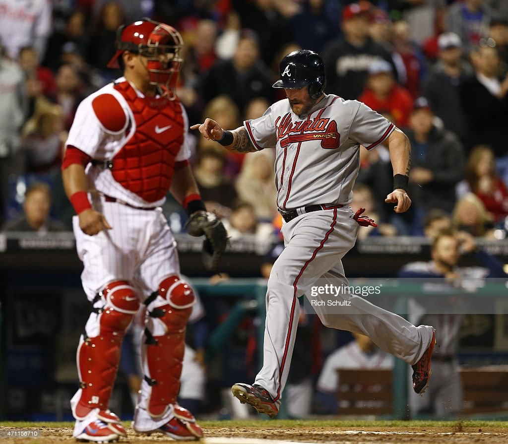 Jonny Gomes #7 of the Atlanta Braves scores on a single by Kelly Johnson #24 during the seventh inning of a game against the Philadelphia Phillies at Citizens Bank Park on April 24, 2015 in Philadelphia, Pennsylvania.