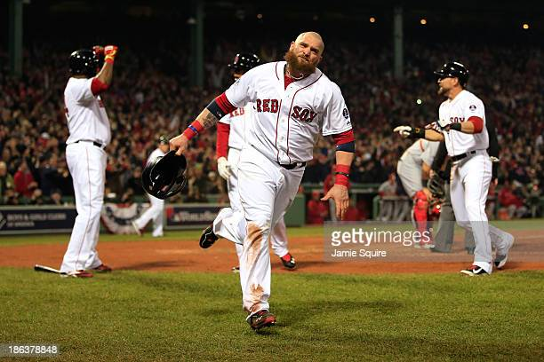 Jonny Gomes of the Boston Red Sox celebrates after scoring in the third inning on a hit by Shane Victorino against the St Louis Cardinals during Game...