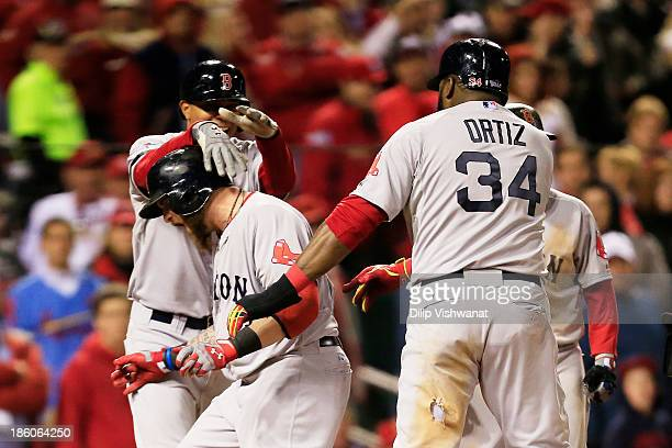 Jonny Gomes of the Boston Red Sox celebrates with teamates David Ortiz Xander Bogaerts and Dustin Pedroia after hitting a three run home run to left...