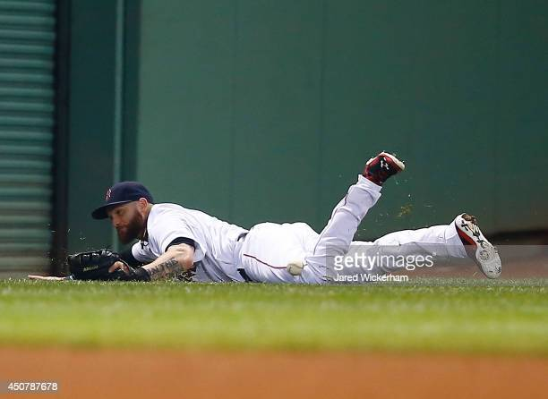 Jonny Gomes of the Boston Red Sox fails to come up with a fly ball in left field against the Minnesota Twins during the game at Fenway Park on June...