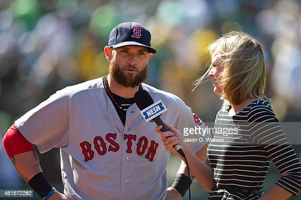 Jonny Gomes of the Boston Red Sox is interviewed by broadcaster Jamie Erdahl after the game against the Oakland Athletics at Oco Coliseum on June 22...