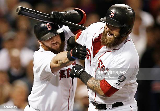 Jonny Gomes of the Boston Red Sox left tries to pull the beard of Mike Napoli of the Boston Red Sox after Napoli homered during the sixth inning of...