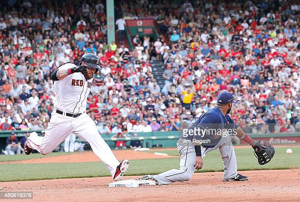 Jonny Gomes of the Boston Red Sox legs out an infield hit as Carlos Santana of the Cleveland Indians fields a late throw in the fourth inning at...