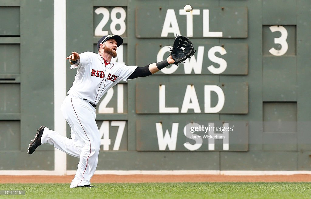 Jonny Gomes #5 of the Boston Red Sox makes a catch in left field against the New York Yankees during the game on July 20, 2013 at Fenway Park in Boston, Massachusetts.