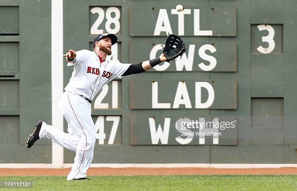 Jonny Gomes of the Boston Red Sox makes a catch in left field against the New York Yankees during the game on July 20 2013 at Fenway Park in Boston...