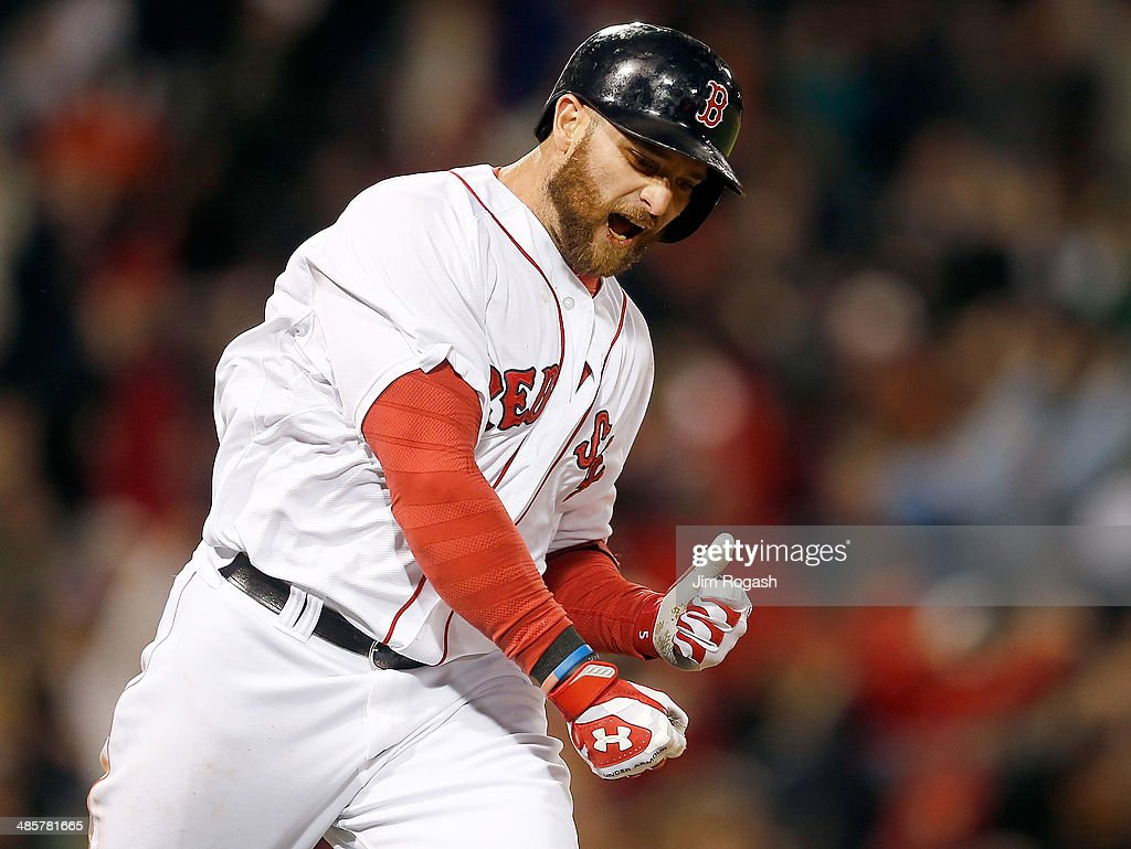 Jonny Gomes #5 of the Boston Red Sox reacts after hitting a three-run home run in the sixth inning against the Baltimore Orioles at Fenway Park on April 20, 2014 in Boston, Massachusetts.