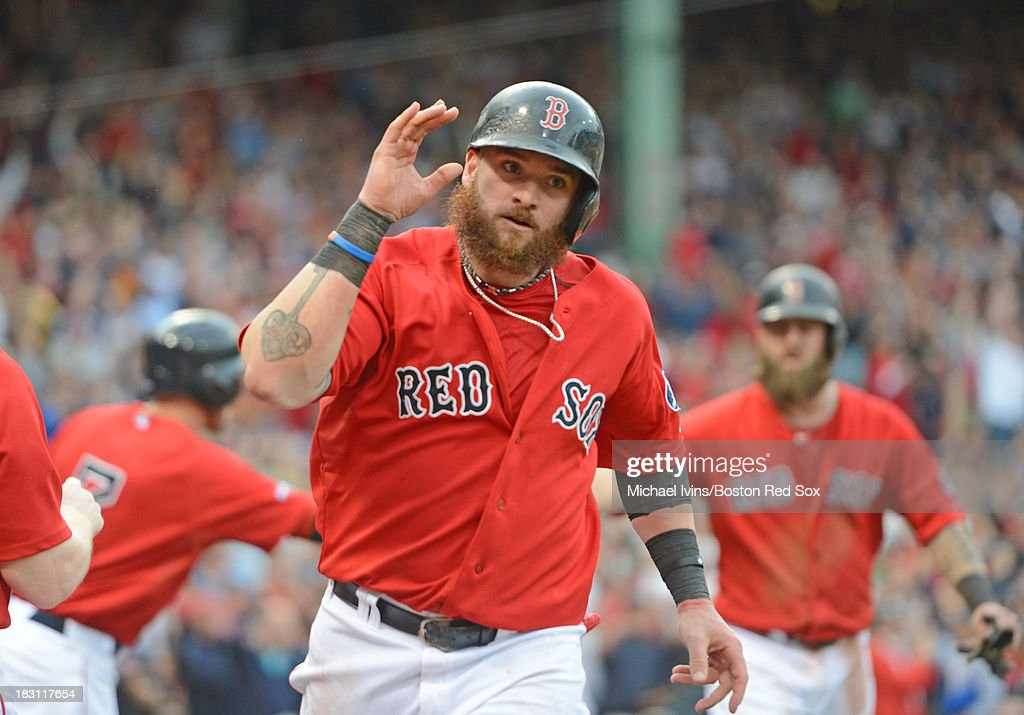 Jonny Gomes #5 of the Boston Red Sox reacts after scoring a run against the Tampa Bay Rays during the fifth inning of game one of the American League Division Series on October 4, 2013 at Fenway Park in Boston, Massachusetts.
