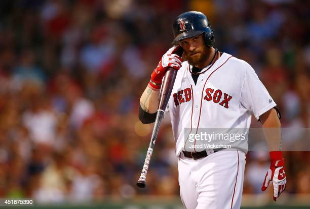 Jonny Gomes of the Boston Red Sox reacts after striking out against the Chicago White Sox during the game at Fenway Park on July 8, 2014 in Boston,...