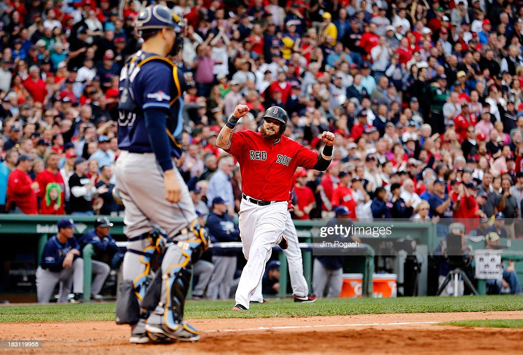 Jonny Gomes #5 of the Boston Red Sox reacts as he runs to home plate against the Tampa Bay Rays during Game One of the American League Division Series at Fenway Park on October 4, 2013 in Boston, Massachusetts.