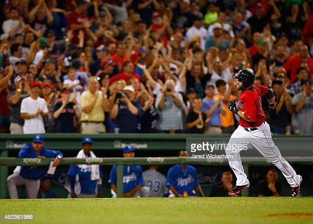 Jonny Gomes of the Boston Red Sox reacts while rounding third base after hitting the goahead tworun home run in the sixth inning against the Kansas...