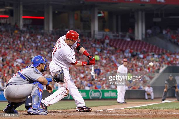 Jonny Gomes of the Cincinnati Reds hits a threerun home run in the fifth inning against the Chicago Cubs at Great American Ball Park on June 6 2011...