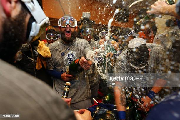 Jonny Gomes of the Kansas City Royals celebrates with teammates in the clubhouse after defeating the New York Mets to win Game Five of the 2015 World...